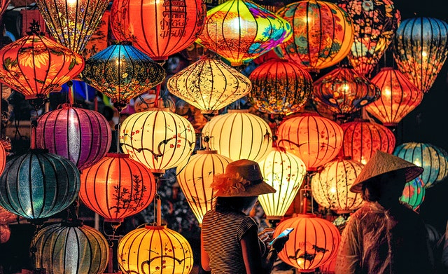 two-person-standing-near-assorted-color-paper-lanterns-1313814.jpg